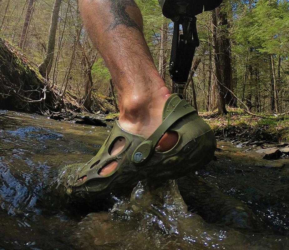 A man wearing Hydro Moc Merrell shoes.