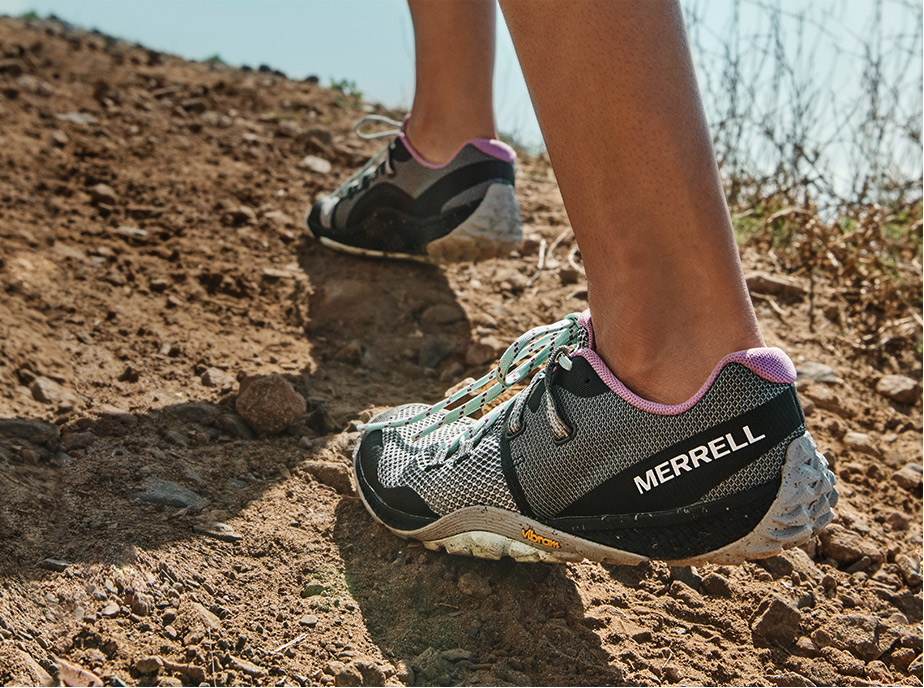 Someone hiking in Merrell shoes.