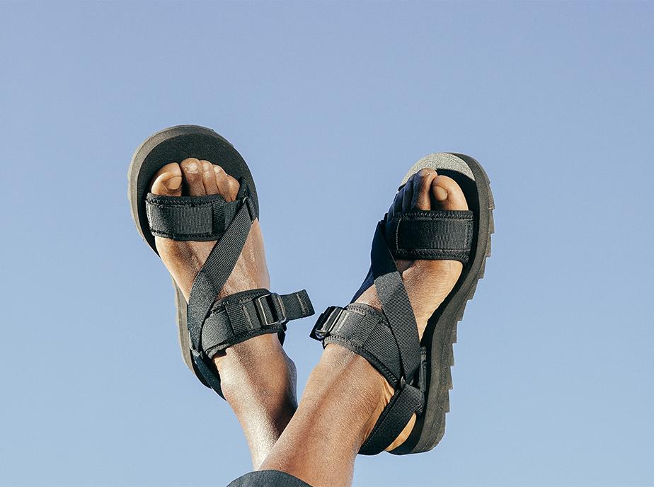 Someone in Merrell Summer Sandals.