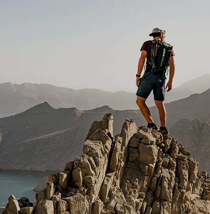 Man hiking up a mountain.