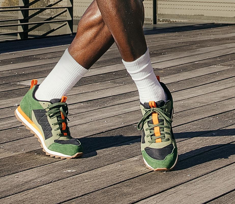 A man wearing Alpine Sneaker Merrell shoes.