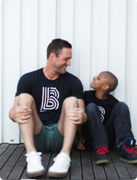 Man and boy hanging out and smiling