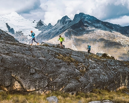 3 people running in the mountians