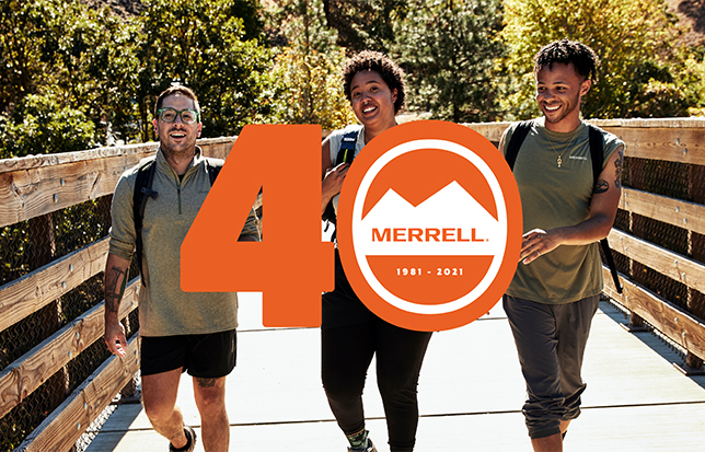Logo for Merrell 40 years 1981-2021 floating in front of young happy people walking on a bridge.