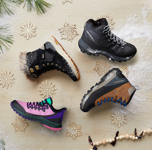 A family of winter boots against a festive background.