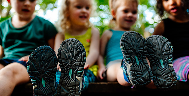 Four kids in Merrell shoes.