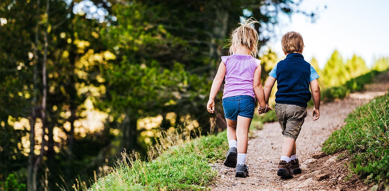 Two kids hiking.