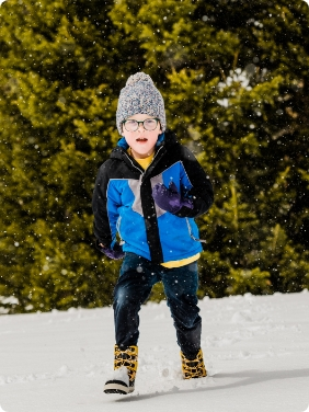 Kid playing in the snow with Merrell Boots