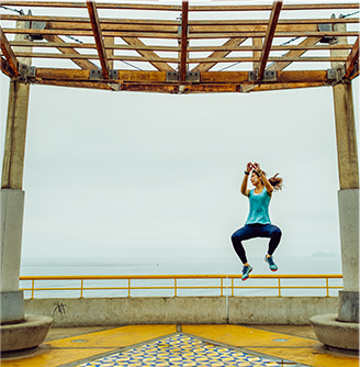Woman Jumping with Trail Glove Shoes