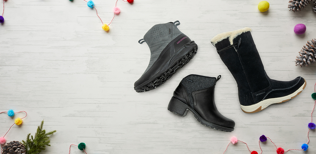A collection of winter boots against a white background.