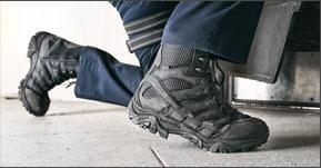 Close up of Merrell black tactical boots.