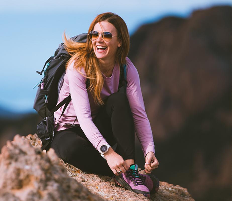 Woman hiking wearing Bravada boots