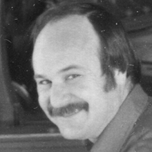 A young Randy Merrell sporting a mustache as thick as a brush.