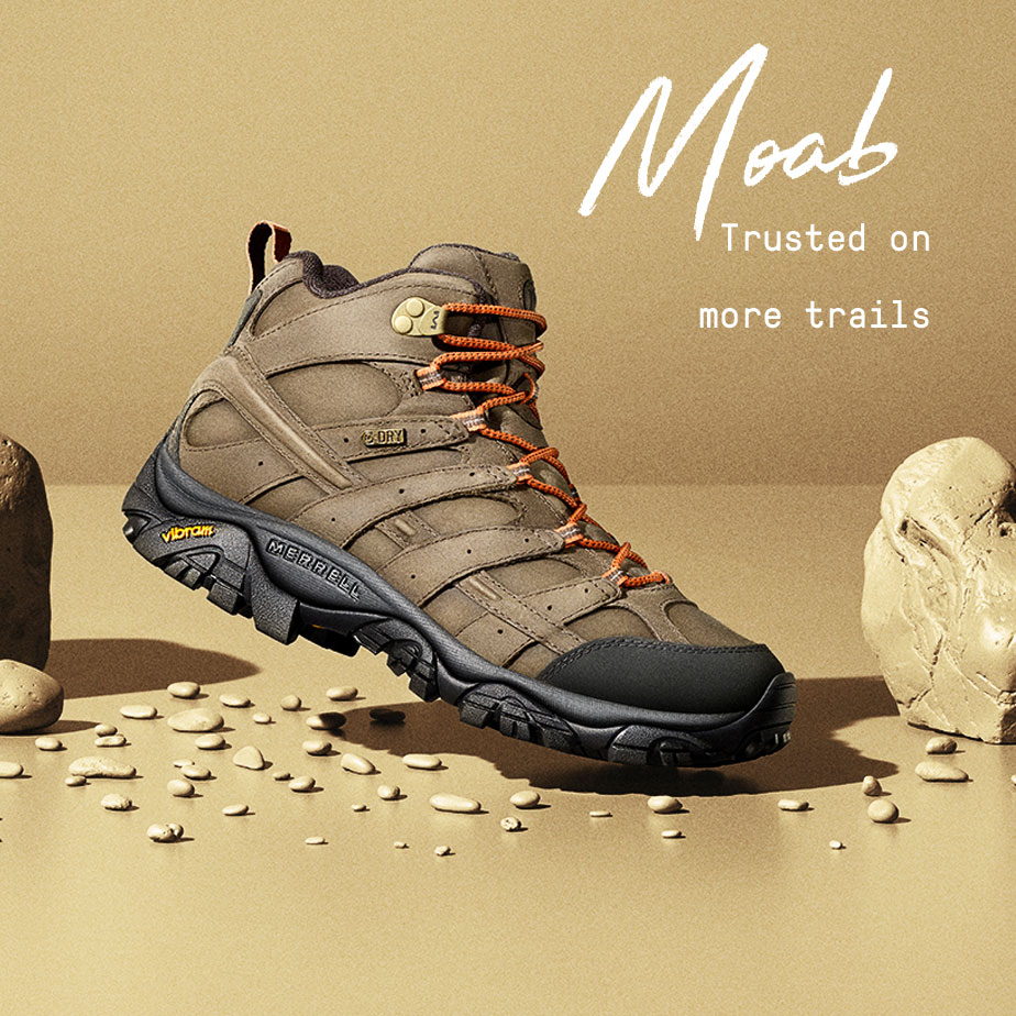 Moab - trusted on more trails | A hiking mid shoe hovering over a collection of pebbles in a display.