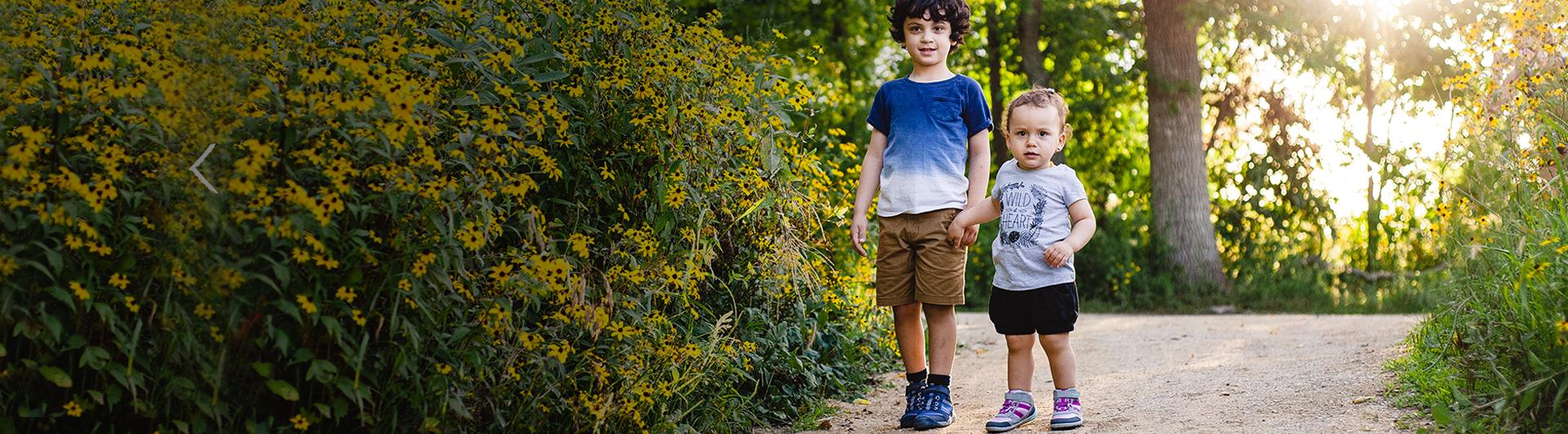 Two Kids walking on a trail