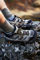 Merrell hiking boots on a rock.