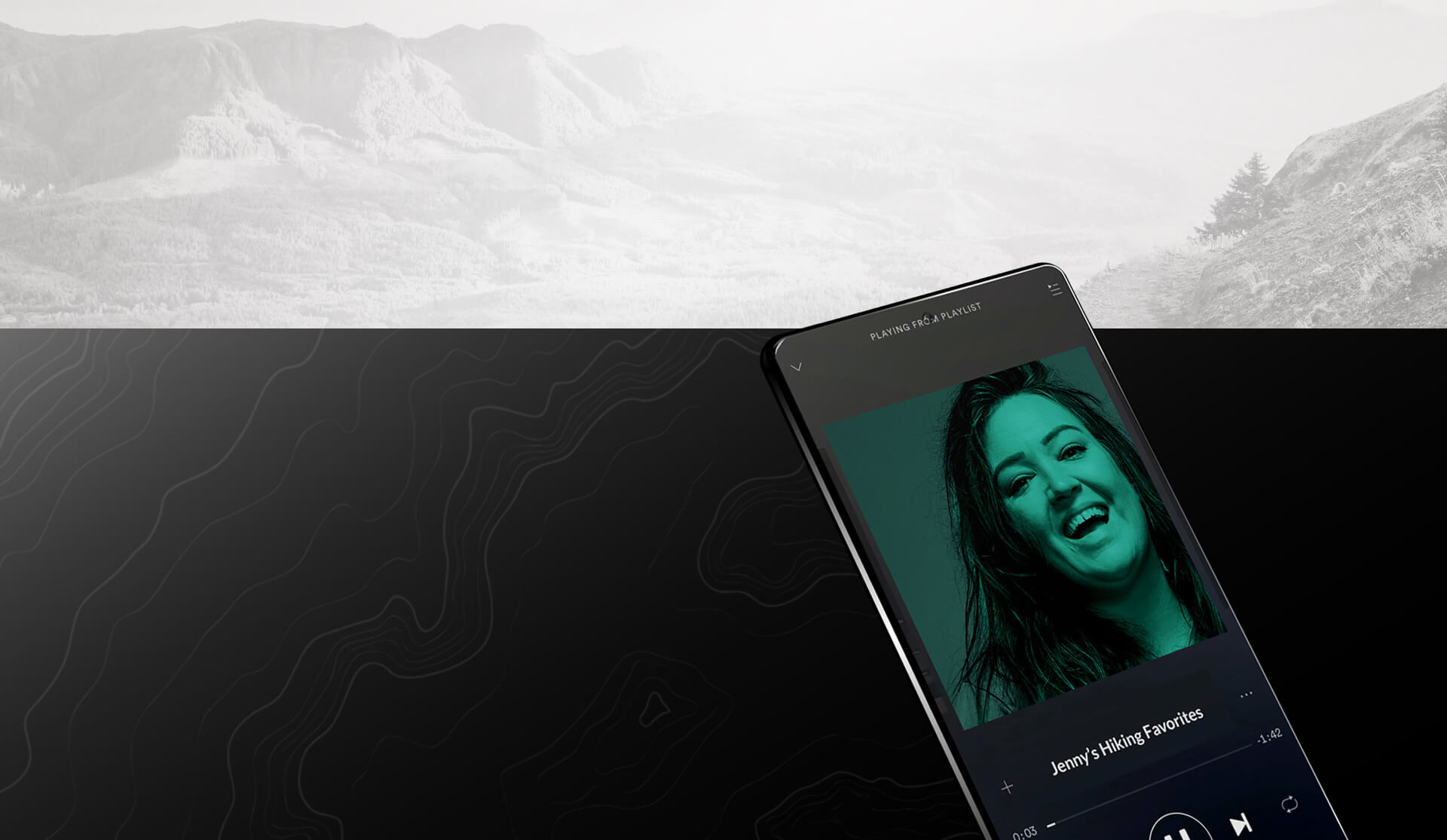 Jenny Bruso's face on a phone in front of a mountain range.