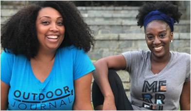 Kenya and Michele Jackson-Saulters with glowing smiles sitting on stone steps.
