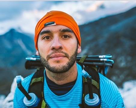 Guy with orange hat in the mountains