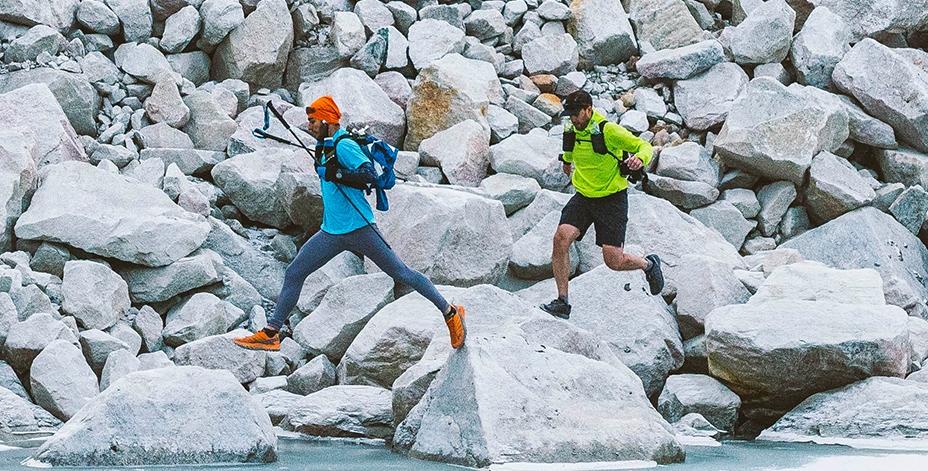 2 Men running on rocks
