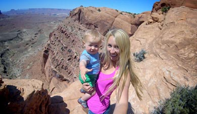 Brooke Froelich bravely holding her infant just feet away from the edge of a 200 foot canyon wall.