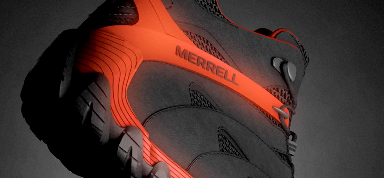 A close-up on the heel sole of a mid-rise orange and black hiking boot.