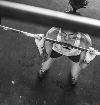Looking down from directly above a person lifting a bar.