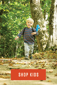 Shop Kids Graphic | young boy walking in woods with backpack