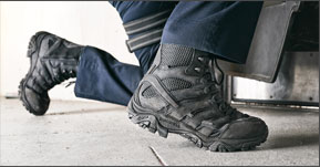 Close up of Merrell black tactical boots.