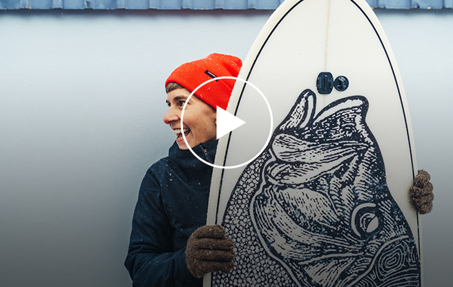 Kat holding a surfboard.