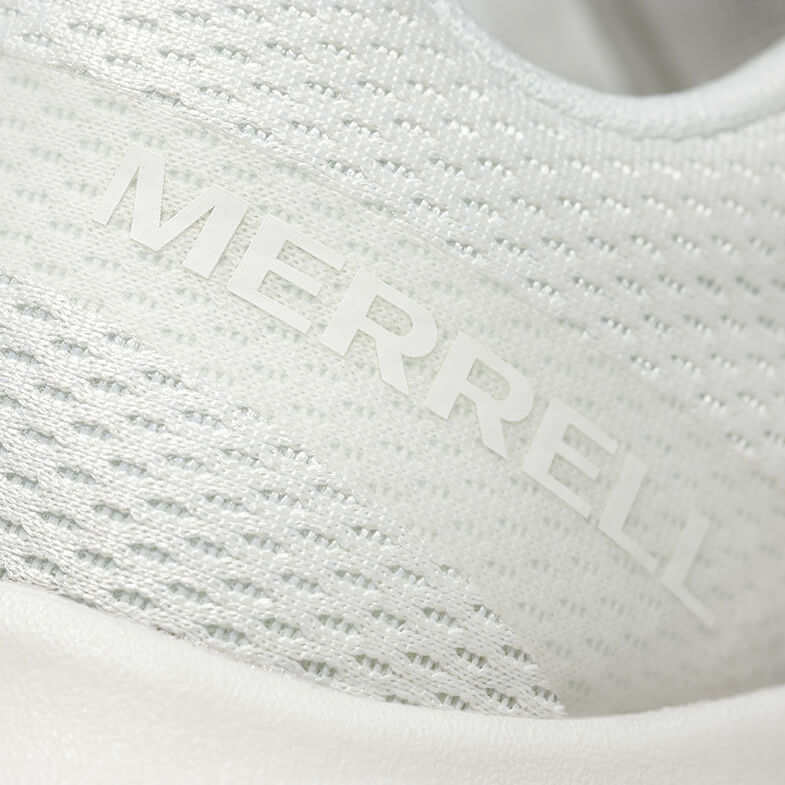 A closup of the Undyed shoe texture showing breathability and the Merrell logo in white.