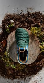 Merrell teal slip on shoes.