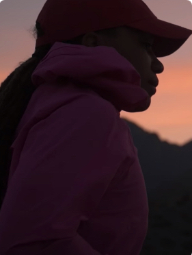 Silhouette against a mountain background