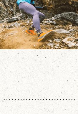 Runner sliding on dirt and rocks
