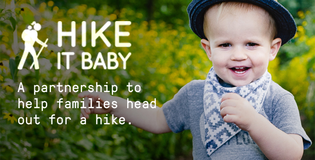 Hike It Baby | A partnership to help families head out for a hike. | Three year old boy with a bandana and hat walking in the woods and smiling