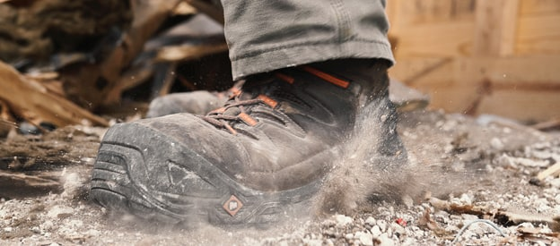 Merrell Strongfield work boot in a cloud of dust.