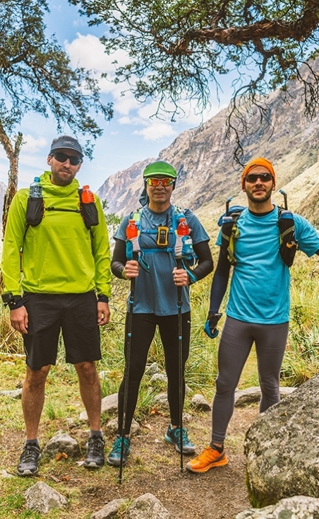 Runners posing in the mountains after a run