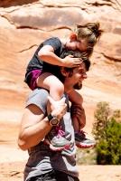 Little kid on parent's shoulders.