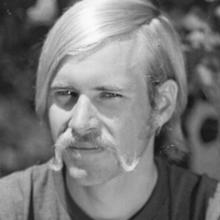 A young Clark Matis sporting a magnificent handlebar mustache.