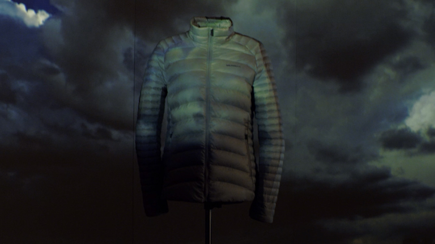 Ridgevent jacket with dark clouds behind it