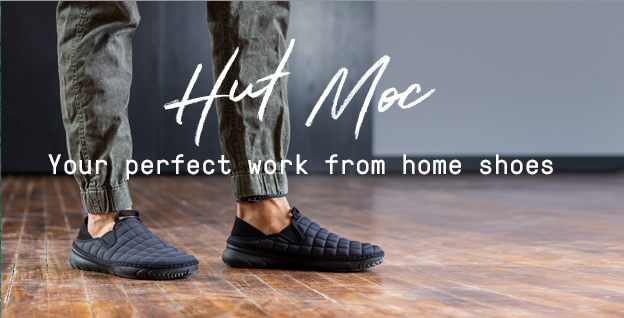 Hut Moc - Your perfect work at home shoes | Black hut moc slippers in a cozy home setting.